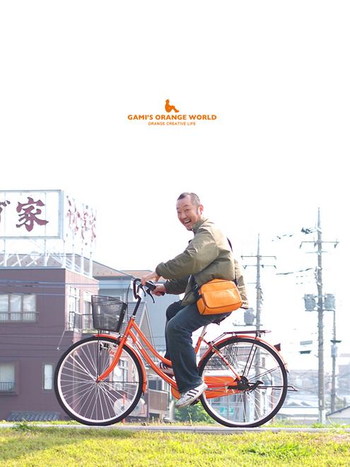 0603居間人斉藤さんのオレンジ自転車 のコピー.jpg
